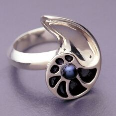 silver and black pearl ring inspired by a chambered nautilus, made by the architect