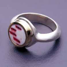 a ring made from shell, 18K gold and brushed sterling silver