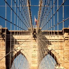 Brooklyn Bridge, with solid, cathedral towers & webs of steel rope : the world's best bridge